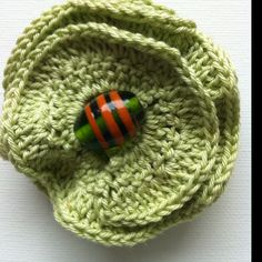 Layered crochet brooch with glass bead