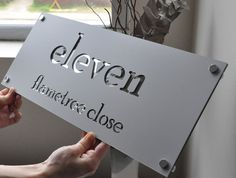 Made to order, large laser cut house sign. Made from anodized aluminium with mirror perspex back plate.Size x x with all mounting hardware x stainless steel mounts)Font and Size can be customised to customer requirements, please contact us. Door Name Plates, Name Plates For Home, House Name Plates, Laser Cut Signage, Metal Signage, Metal House Signs, Trotec Laser, Wc Sign, Signage Board
