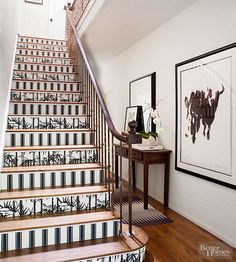 Stair risers have to be one of the most creative places to wallpaper. And mixing it up with two different patterns? Major creativity props. Plus, you don't need a ton of wallpaper, so it's a low-cost update with high impact. Get it:Bamboo BP 2119 and Block Print Stripe BP 754, Farrow & Ball; farrowandball.com/