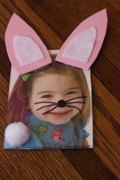 Easter Bunny Frame: use a $ store plastic frame that is also a magnet. Cut out & glue on the ears & white tail. Put your child's picture inside the frame. Then on the outside of the frame (so you don't actually draw on your child's picture) make a bunny nose & whiskers! Supplies: Pink foam sheet or construction paper, glue, sharpie, cotton ball or white pom pom, white felt or white paper, plastic frame & picture of your child.