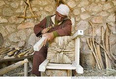 """Nazareth, Israel: A """"carpenter"""" hammers together a chair at the Nazareth Village. Photo by David Blumenfeld/Special to The Chronicle Photo: David Blumenfeld/Special To The"""