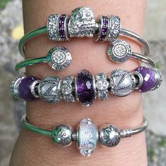 I love the new Purple Shimmer Murano and built this stack around that one bead !  #pandorabracelets #pandorabeads #theofficialpandora #officialpandora #myarmparty #pandoraaddict #purple #crystals #muranobeads #signature #silverbangle #glassbeads #owl #family #new #pandoracollection #frostymint #shimmer #purplelove #uniqueasyouare