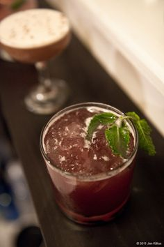 The Big Sleep  1.5 oz Scotch  0.5 oz Benedictine  0.5 oz Lime Juice  0.5 oz Creme de Cassis  2 drops Absinthe  2 dashes Whiskey Barrel Bitters  2 drops Rosewater