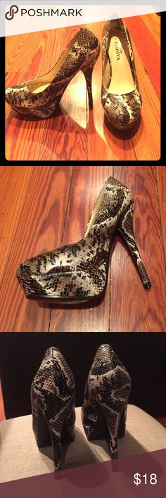 """Lady Godiva Python Print Platform Cone-Heel Pumps Sky high, sexy platform almond toe pumps. The 5.5"""" cone heel is a classy detail, and the 1"""" platform absorbs shock so you can go all night! This is a tan/khaki/brown and cream textured Python synthetic leather. Fits a true size 6.5, but I would say that if the base of your foot is a little on the wide side, this would be comfortable for you. Worn once to work and cleaned inside and out using shoe wipes. The 4th picture depicts very minor…"""