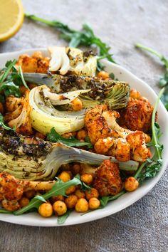 Garlicky & Lemony Oven Roasted artichokes, cauliflower, onion and chickpeas seasoned with dried oregano, basil, cumin and smoked paprika #collectingmemoriess