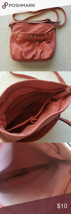 Pink bag There are stains in the bottom of the front pocket( seen in photo above)some stains on inside Rosetti Shoulder bag Also dark smudge on bottom and side( seen in photo) Rosetti Bags