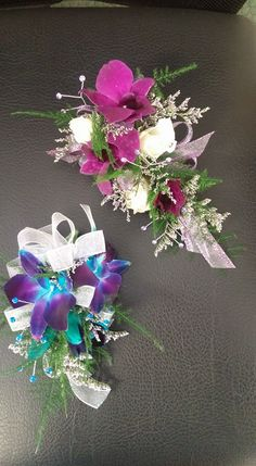 Corsages for 2 wonderful ladies. Blue dendrobium orchids with teal rhinestone bling. the other is dark purple/magenta dendrobium orchids with white spray roses and clear bling. Corsage And Boutonniere, Boutonnieres, Blue Dendrobium Orchids, Magenta, Teal, White Spray Roses, Prom Flowers, Order Flowers Online, Wrist Corsage