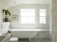 A Star Is Born: A Rehabbed London Maisonette from a Newly Minted Designer, High/Low Secrets Included - Remodelista Modern White Bathroom, White Bathroom Tiles, Bathroom Spa, White Tiles, Small Bathroom, Master Bathroom, White Bathrooms, Bathroom Ideas, Funky Bathroom