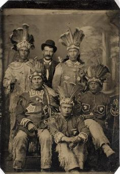 ca. 1875, [tintype portrait of five Native American men posed with a white man in Western attire]