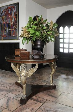 Decorating with Tea Caddies- a pair of lovely inlaid tea caddies are displayed next to a large (treen?) urn filled with magnolia leaves...beautiful!