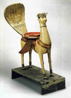 Al-buraq, Copenhagen Nationalmuseet, Dept. of Ethnography; Inv. DA 758. The inspiration for the Al-buraq, according to T.W. Arnold, was drawn from many pre-Islamic representative traditions in western Asia, including the centaur of Babylon, the 'man-headed bulls' of Assyria and the Sphinx.