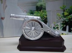 The sliver Canon Trophies, Corporate awards, sports awards made out of ceramic with mat & shiny silver coating. This item can be a nice reward to office staff. It can also be a reward to football player as the shape of the bomb of this canon is football, so it is quite a interesting items as football trophies The item number is MD12285 Our email is sale1@hpceramics.com Web: http://www.hpceramics.com