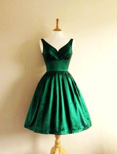 Emerald green adds a glamorous touch to the shorter cocktail dress.