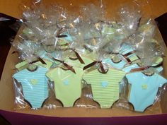 Onesie Cookies for a baby shower.  Covered in fondant with fondant accents.