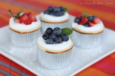 mini cheesecakes or cupcakes with blueberries...  and maybe a little kiwi?