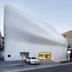A curving concrete shell encases Paul Smith's flagship store in South Korea.