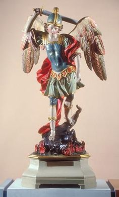 St Michael Slaying the Dragon, c.1700, José de Mora; Michael is shown with his symbolic attributes: angelic wings, a sword and armour, and a dragon, symbol of Satan. (Government Art Collection)