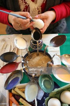 A Sorb egg painter decorates an Easter egg while using bent spoons full of melted wax as coloring at the annual Easter egg market on March 2013 in Schleife, Germany. Easter is a particularly important time of year for Sorbs, a Slavic minority . Egg Crafts, Easter Crafts, Bent Spoon, Polish Easter, Carved Eggs, Egg Tree, Easter Egg Designs, Ukrainian Easter Eggs, Coloring Easter Eggs