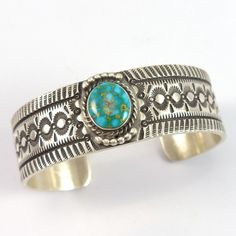 "Sterling Silver Cuff Bracelet with Hand Stamped Designs and set with Natural Carico Lake Turquoise from Nevada. Learn More About Stamped Designs .75"" Cuff Width 5.5"" Inside Measurement, plus 1"" openin"