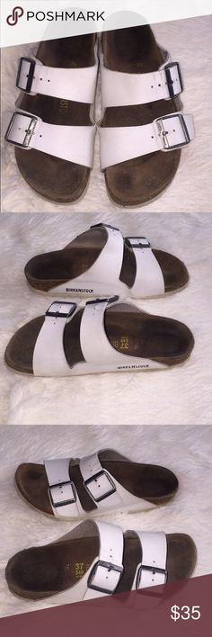 Size 37 white birkenstocks💚 Super cute size 37 white two strap Birkenstocks. I have unfortunately out grew these super cute shoes. They have been worn and show a few signs of it but are in over all good condition. Have light marks where the buckle has been previously and a tiny bit of fraying of the cork on the heel! Birkenstock Shoes