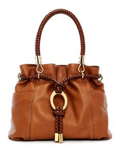 Michael Kors Skorpios Pebbled Leather Drawstring Satchel.