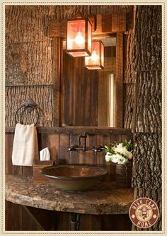 Rustic Bathroom with bark walls.