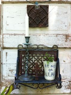 My friend LeeAnne's garden vignette art.    Shabby chic, NOLA inspired, rusty cast iron, handmade pottery, weathered…    Favorite things!