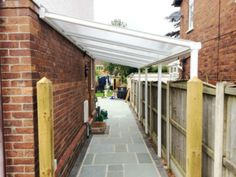Patio Veranda: Newcastle-under-Lyme, Staffordshire - Mrs Zandy - Canopies, Carports & Verandas Rustic Pergola, Curved Pergola, Shed Design, Garden Design, Lean To Roof, Lean To Shed, Shed Landscaping, House Extension Design, Garden Tool Storage