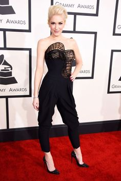Gwen is perfection in an Atelier Versace jumpsuit. Love that she took a risk and went without her signature red lip for this look.