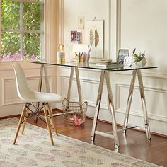 With this Colton Mix & Match Desk combination, a sleek glass top and high-shine chrome sawhorse base combine for a contemporary workstation. (link in profile to #shop) #WorldMarket #HomeOffice #HomeDecor
