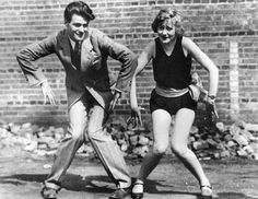 """Couple Dancing the Charleston - Norwegian pole vault champion, Charles Hoff, dances with Tempest Stevens in a Charleston contest."" June 21, 1926 © Bettmann/CORBIS [Stock Photo ID: U340058INP]"