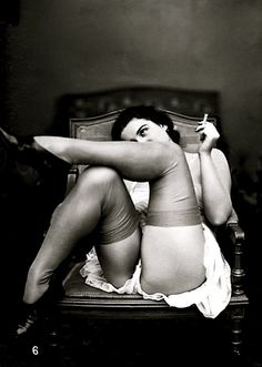 French postcard, 1930's | vintage french beauty | casually seated | sexy | armchair | vintage black & white photography | stockings and high heels | suspenders | Paris | knickers |