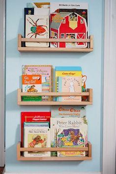 Book display using Ikea spice racks.  DIY additions can be used to make it portable (eg plywood backing and castors).  Can also be painted.