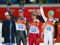 DAY 3:  (L-R) Silver medalist Peter Prevc of Slovenia, gold medalist Kamil Stoch of Poland and bronze medalist Anders Bardal of Norway celebrate during the flower ceremony for the Ski Jumping Men's Normal Hill Individual Fina