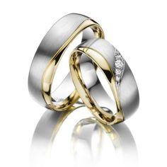 Acredo aparte trouwringen geel gouden en wit gouden deel
