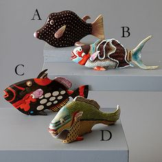 Four Assorted Decorative Tropical Fish Designed by Fabienne Jouv: Tozai Home Four Assorted Tropical Fish. A beautiful depiction in realistic color, showing off these wonderful fish. Handpainted ceramic by accomplished artist and designer, Fabienne Jouvin.   From 1 3/4