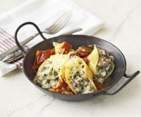 Jumbo pasta shells are stuffed with hot sausage, mushrooms, and cheese and baked in a rich eggplant sauce for this casserole.