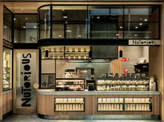 A welcoming, wood-covered storefront designed by Luchetti Krelle in Sydney's Galeries Victoria invites snacky shoppers to try healthy handmade treats at Nutorious.