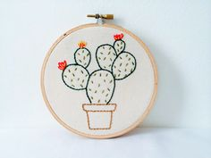 Perfect for a cactus queen, or maybe a cacti admirer who lacks a green thumb. A perfect prickly pear, hand embroidered cactus, in full bloom.