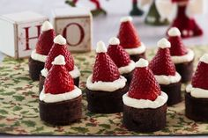 Bite-size choc brownies topped with strawberry Santa hats make for a fun and festive sweet treat.