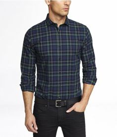 men's plaid shirt tucked in taylored jeans