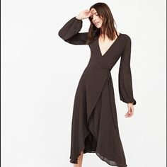NWT Reformation Chamomile midi wrap dress MIDI wrap dress with plunging neckline, sheer billowy sleeves and higher hem in the front. Marked size XS but would probably fit up to a US 4 because of wrap style. Reformation Dresses Midi