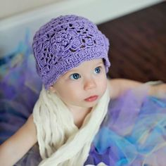 2H Handknits Lavender Crochet Hat With Flower. Purple knit fitted cap with rose motif. See More Hats at http://www.ourgreatshop.com/Hats-C198.aspx