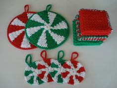 Christmas Hostess Set crocheted in red, green and white cotton includes pot holders, coasters and dishcloths. via Etsy.