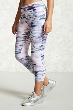 A pair of athletic stretch-knit capri leggings featuring an allover abstract print, an elasticized waist, and moisture management.<p>- Matching top available.</p>