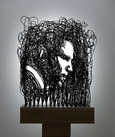 Portrait: Measures 2'x2'x9', created using 1000 feet of wire, black enamel and poplar base.
