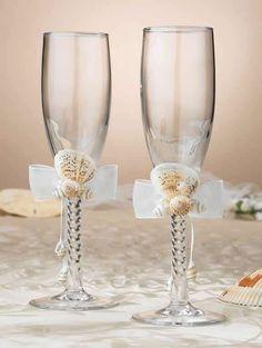 Seashell Toasting Glasses - Beach Theme Flutes  Seashell toasting glasses are perfect for that destination beach theme wedding. Unique design shows off seashells on each toasting glass