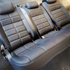 Landrover defender 2nd row 60/40 seat re-trimmed in black Nappa leather with a fat biscuit design by www.ruskindesign.co.uk