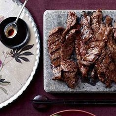 This succulent recipe is based on bulgogi, a classic Korean dish of sliced beef that's marinated in soy sauce, sugar, sesame oil, and garlic, then grilled. In this version, a bit of crushed red pepper is added to the marinade for heat.