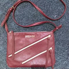LAST CHANCE Kenneth Cole Crossbody Sleek Burgundy with Gold accent. Great condition. Kenneth Cole Reaction Bags Crossbody Bags